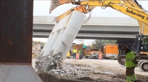 Demolition of the old bridge to prepare for the new construction to be slid into place.
